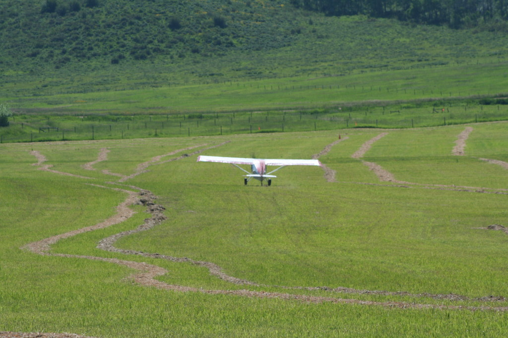 Grass strip takeoff in the mountains of Colorado